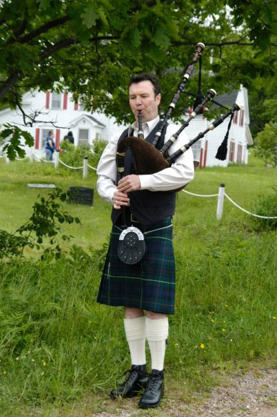 Bagpiper at North Highland Community Museum - Cabot Trail Attraction